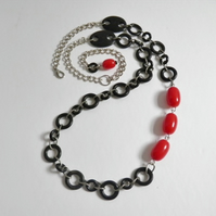 Asymetrical, bead and chain necklace.  Long, red and black, asymetrical necklace
