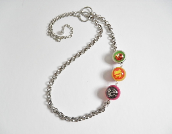 Asymetrical, bead and chain necklace.  Long, silver and bright coloured, asymetr