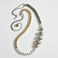Asymetrical, bead and chain necklace.  Long, silver, gilt and gunmetal, asymetri