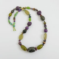 Long, chunky, green and mauve, statement necklace.