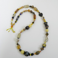Long, chunky, grey and yellow, statement necklace.