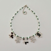 Crossword jigsaw necklace.  Beaded jigsaw necklace.