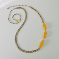 Asymmetrical, chain and bead necklace.  Long gold and yellow necklace.