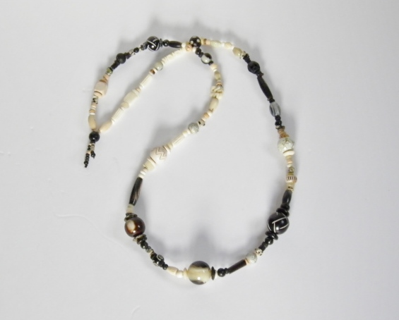 Long, black and white, statement necklace.