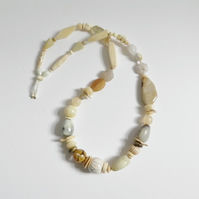 Long, chunky, pale natural coloured necklace.  Statement, bead necklace.