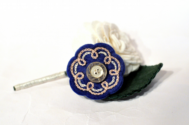 Ivory rose buttonhole with blue embroidered felt flower detail