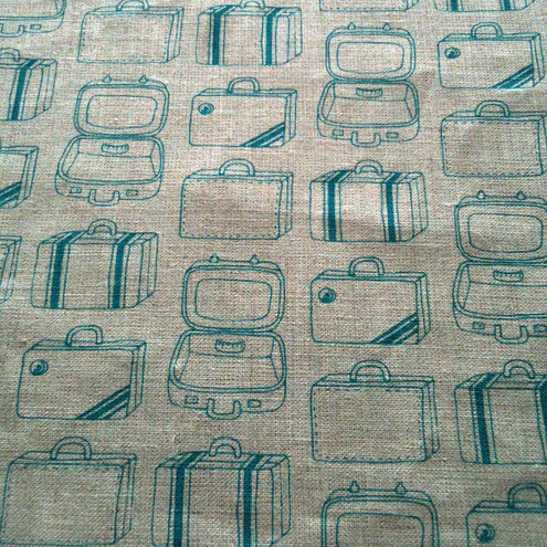 Hand printed Teal Suitcases fabric on Linen