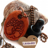 Essential Lavender Oil Diffuser with a Ceramic Intertwined Tree Pendant. A5