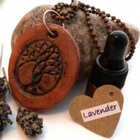 Essential Lavender Oil Diffuser with a Ceramic Intertwined Tree Pendant. A15
