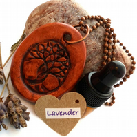 Essential Lavender Oil Diffuser with a Ceramic Intertwined Tree Pendant. A13