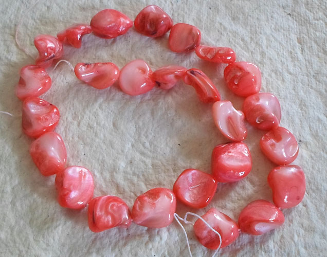 "16"" strand of Pinky Red shell pebbles"
