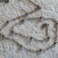 2 metre length of fine chain and Ball