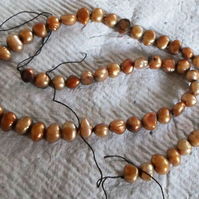 strand of light copper coloured Fresh water pearls