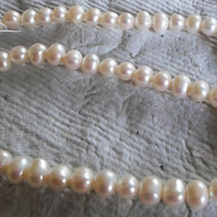Strand of Ivory fresh water potato pearls