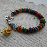 Multi coloured shell bracelet with a yellow skull Charm