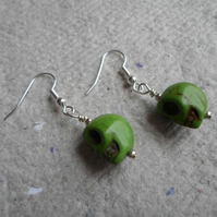 Pair of Howlite Skull earrings in Green