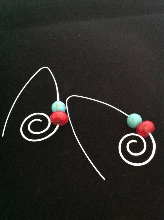 Long silver arc swirl earrings