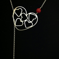Heart in heart lariat necklace