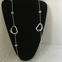 Contemporary long silver and glass loop necklace