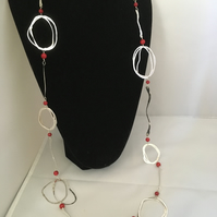 Contemporary long silver and coral necklace