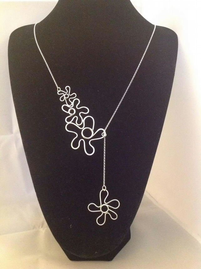 Three flower lariat necklace