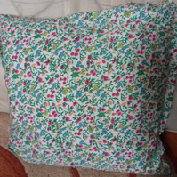 Homemade Pink flowers on a white background cushion.