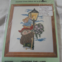"Cross stitch Kit.  Lighting the lamp.  8"" x 12"""