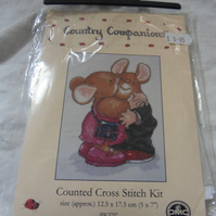 "Cross stitch kit. Hugs and kisses. 7"" x 5"""