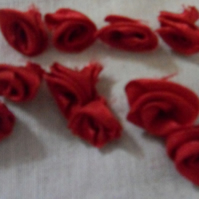 Homemade small red ribbon roses embellishments. Free postage