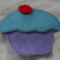 Homemade felt cup cake. Blue icing. Purple cake. Embellishment