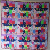 Homemade Scrappy girl,baby quilt.  Mainly girly or pink 100% cotton fabric.