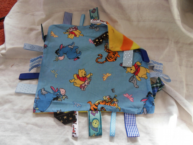"Homemade baby,child taggy, comforter.  Winnie on blue. 12"" x 12"". (13)"