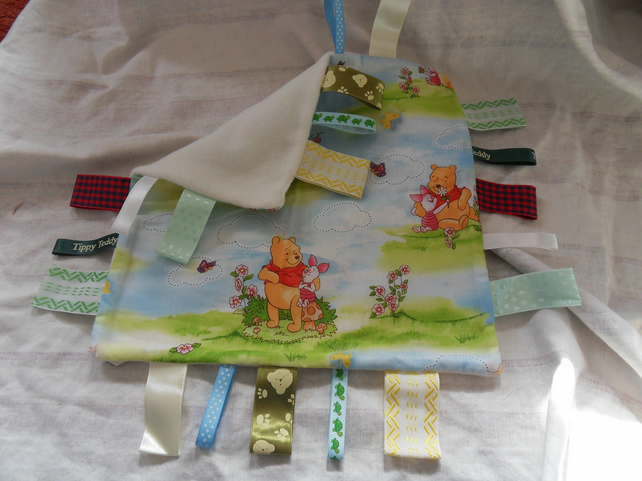 "Homemade baby,child taggy, comforter.  Winnie the pooh. 12"" x 12"". (18)"