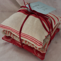 Set of three lavender cushions.  Different reds (5)