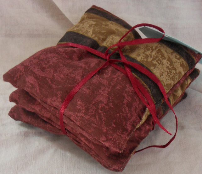 Set of three lavender cushions.  Red-gold (6)
