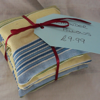 Set of three lavender cushions.  Blue and yellow strip (7)