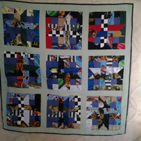 Homemade boys scrappy quilt. starwars, cars, cougars mixture 100% cotton
