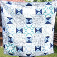 Blue and white patchwork quilt. 100% cotton fabric front and back.