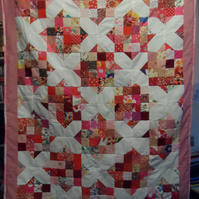 Homemade Noughts and crosses pinks and red patchwork quilt