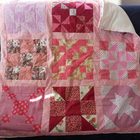 "Homemade Pink and red Sampler Patchwork quilt. 44"" square"