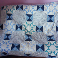 Blue and white patchwork quilt. 100% cotton fabric front and back.(30)