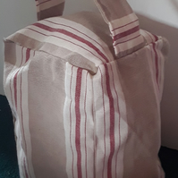 Homemade red and brown strip doorstop. fabric