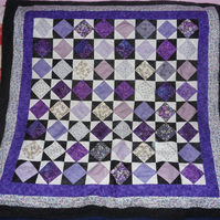 Square in a square black and purple patchwork quilt