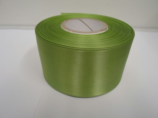2 metres of 50mm sage, light green satin ribbon, double sided