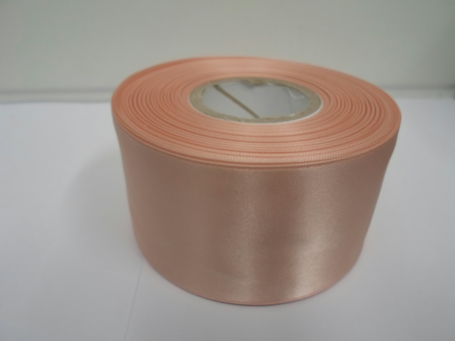 1 roll of 50mm peach, light orange satin ribbon, 25 metres, double sided