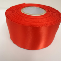 2 metres of 50mm scarlet, bright red satin ribbon, double sided