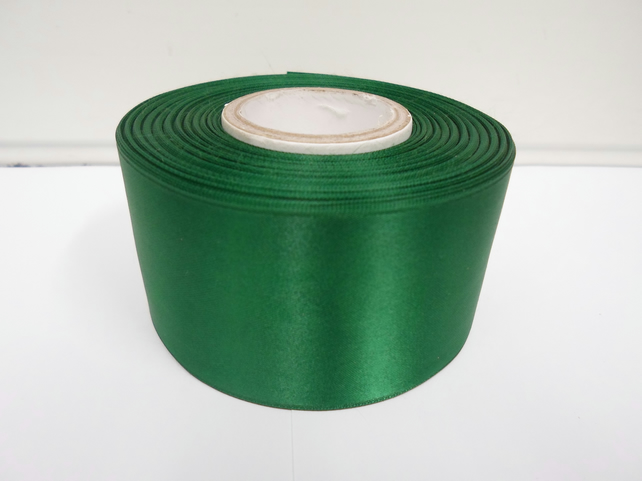 2 metres of 50mm Emerald, dark green satin ribbon, double sided