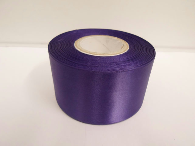 2 metres of 50mm dark purple satin ribbon, double sided