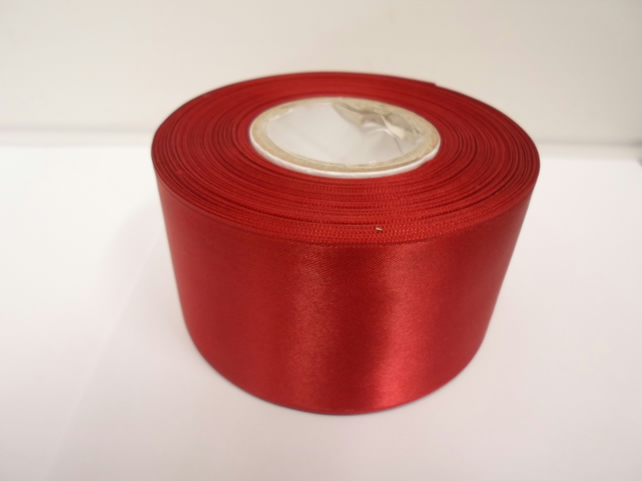 2 metres of 50mm dark red, satin ribbon, double sided