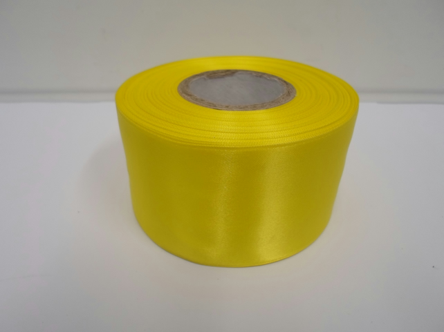 2 metres of 50mm Canary, bright yellow satin ribbon, double sided